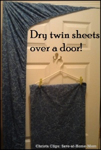 Dry sheets over a door
