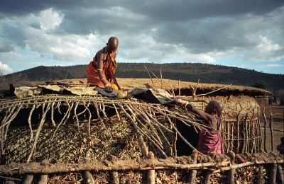 Maasai women repairing a house in Masai Mara (1996 - photo Wikipedia.org)